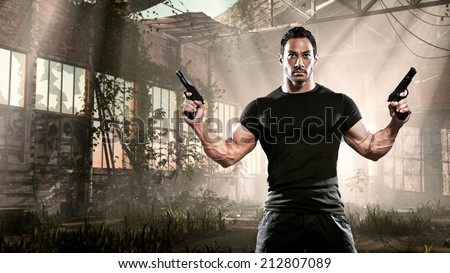 Action hero muscled man holding two guns. Standing in abandoned building. Wearing black t-shirt and pants. - stock photo