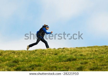 action image of girl running outdoors - stock photo