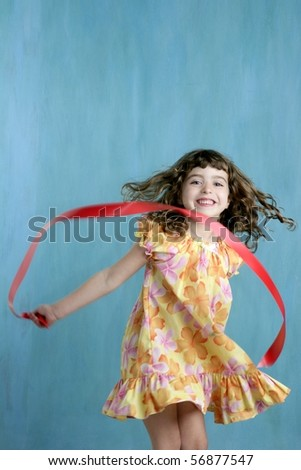action little girl red ribbon tape dancing over green motion - stock photo