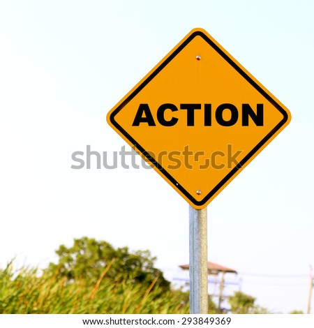 Action on traffic sign - stock photo