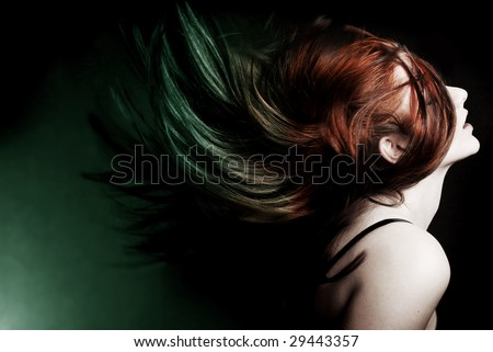 Action shot of an attractive model swinging her hair.