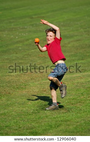 action shot of boy throwing ball - stock photo