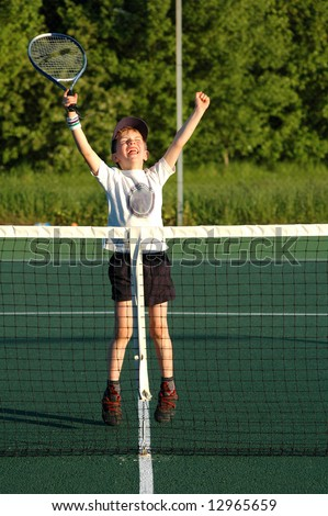 action shot of boy winning tennis - stock photo