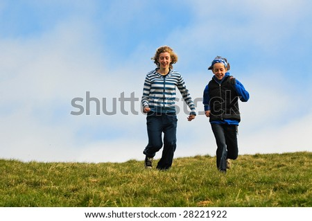action shot of girls running down a hill - stock photo