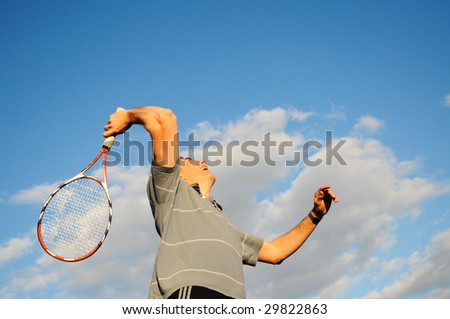 action shot of man playing tennis - stock photo