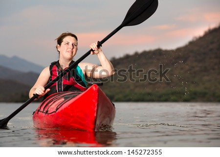 Action Shot of Woman Kayaking - stock photo