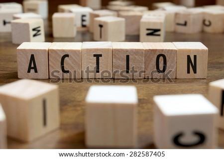action word written on wood block - stock photo