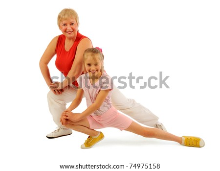 Activ grandmother and granddaughter exercising - stock photo