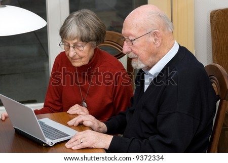 Activ senior people (80s) in front of a notebook - stock photo