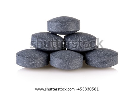 activated coal tablets on white background