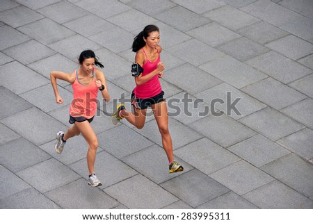 active asian chinese sporty women training outdoors for marathon run in morning - stock photo