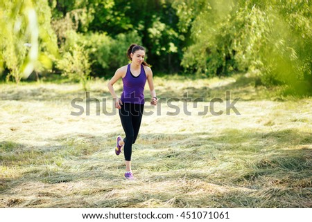 Active attractive running young woman outdoor. Workout in the park, forest, nature. Sport