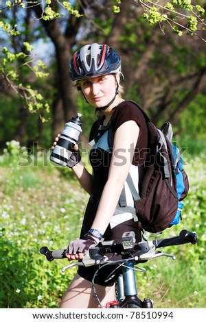 Active bicyclist in the park - stock photo