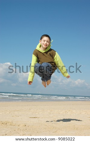 Active boy on the beach on nice winter day