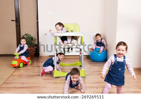 Active child messing around in the kitchen - stock photo