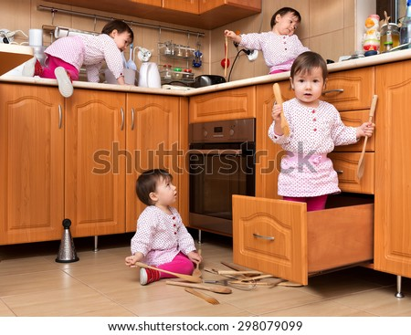Active child playing in the kitchen - stock photo
