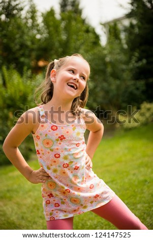 Active childhood - happy child dancing outdoor in backyard - stock photo