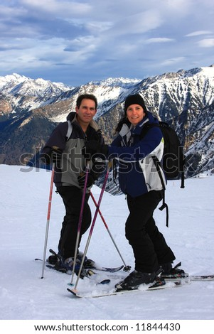 Active couple on a snowy mountain