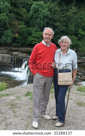 Active devoted senior couple in their 80s  enjoy a day out in the Yorkshire dales, England - stock photo