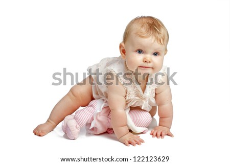 Active eight month old baby girl crawls with determined expression. She wears a dainty sleeveless smocked sun dress. Horizontal, copy space, isolated on white.