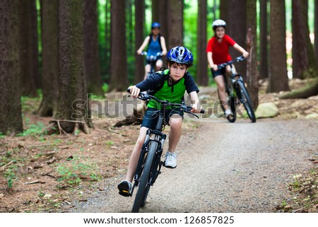 Active family biking - stock photo