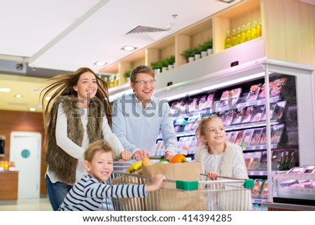 Active family in a store - stock photo