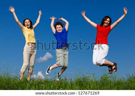 Active family - mother and kids running, jumping outdoor - stock photo
