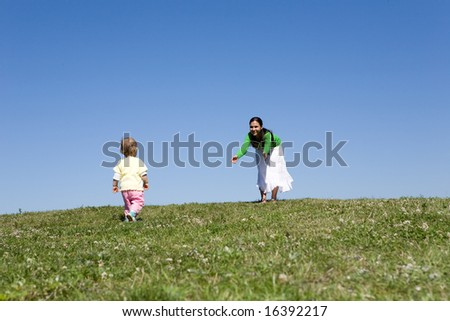 active family on green meadow