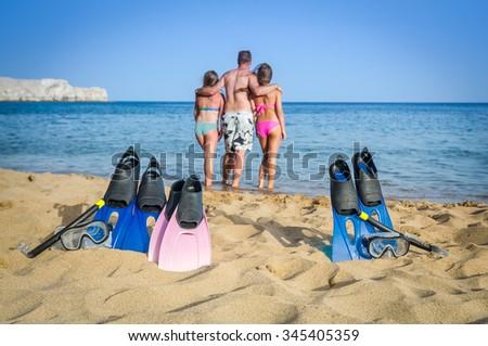 Active family on tropical beach - stock photo