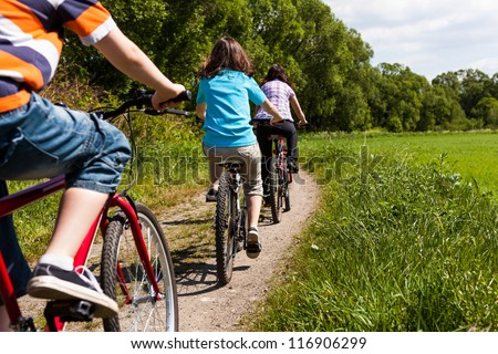 Active family riding bikes - stock photo