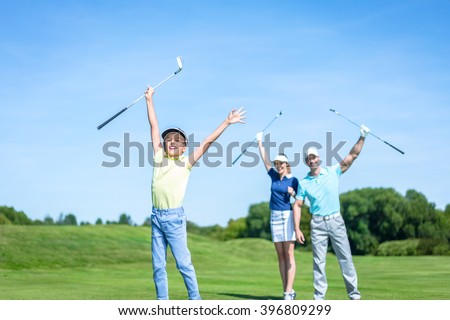 Active family with child on the golf course