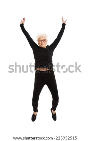 Active fit senior woman cheering