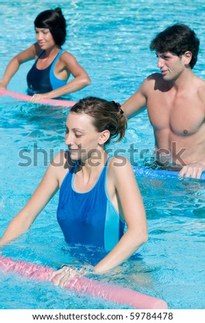 Active fitness people doing exercise with aqua tube in a swimming pool