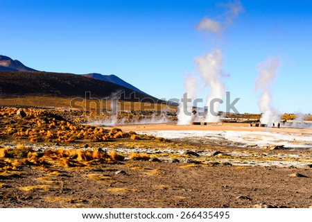 Active geysers come out of the ground, Atacama desert, Chile - stock photo