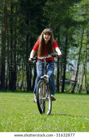 Active girl riding bicycle - stock photo