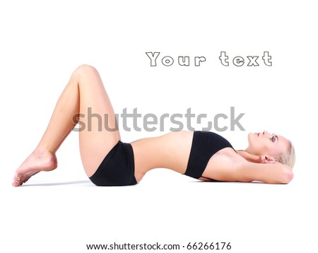 active girl with sporty figure lying on floor - stock photo