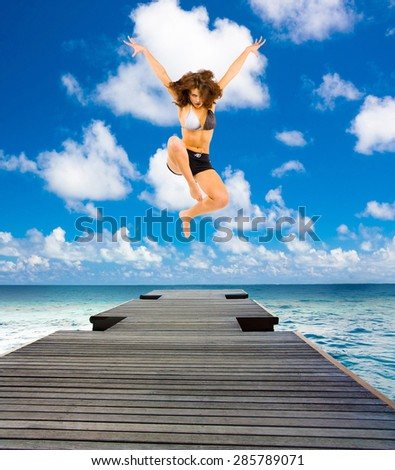 Active Girls Over a Jetty  - stock photo