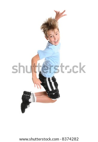 Active happy go lucky boy leaping and smiling.  fitness or concept - stock photo