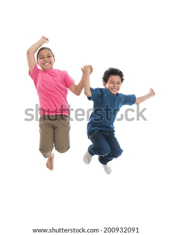 Active Happy Kids Jumping with Joy Isolated on White Background - stock photo