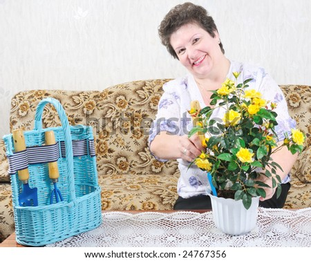 active happy woman with flower - stock photo