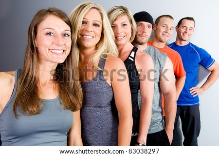 Active, healthy, attractive group of young men and women. - stock photo