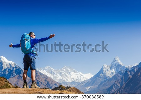 Active hiker hiking, enjoying the view, looking at Himalaya mountains landscape. mountaineering sport lifestyle concept  - stock photo