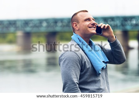Active jogger talking by cell phone. - stock photo