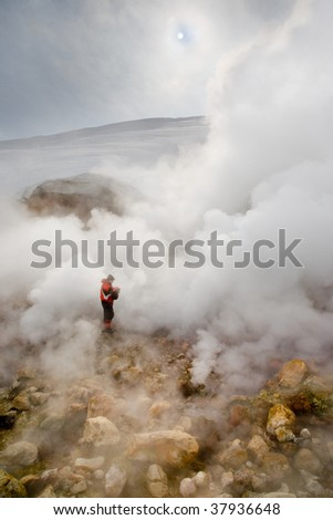 Active kamchatkian geyser of water steam - stock photo