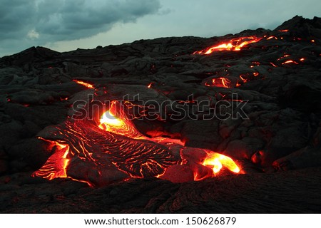 Active lava flowing towards the camera on the Big Island, Hawaii - stock photo