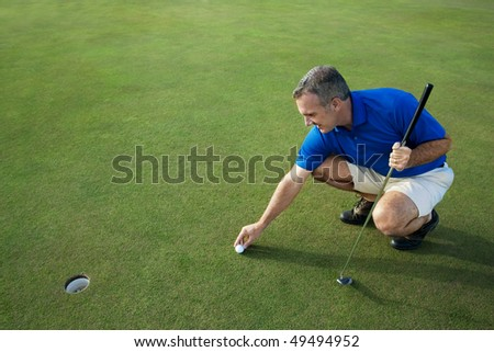 Active Male Golfer Putting - stock photo