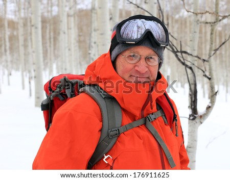 Active male skier with glasses outdoors. - stock photo
