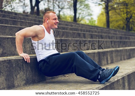 Active man in park exercise.