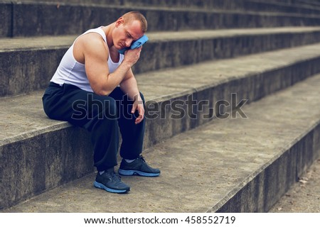 Active man resting in park with towel. - stock photo