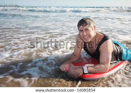 Active Mature Man On Boogie Board - stock photo